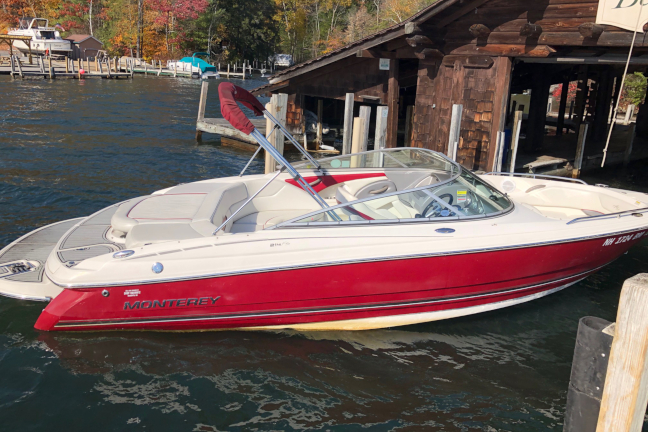 Picture of a red and white 22 foot bowrider boat