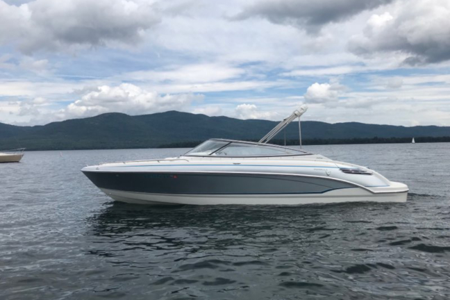 Picture of a gray and white 24 foot bowrider boat